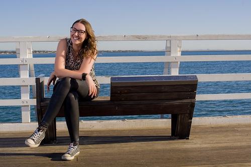 Suki-Sitting-On-Bench